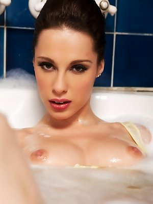 Nikita Bellucci gets all lathered up in a hot bubble bath and plays with her feet and pussy.